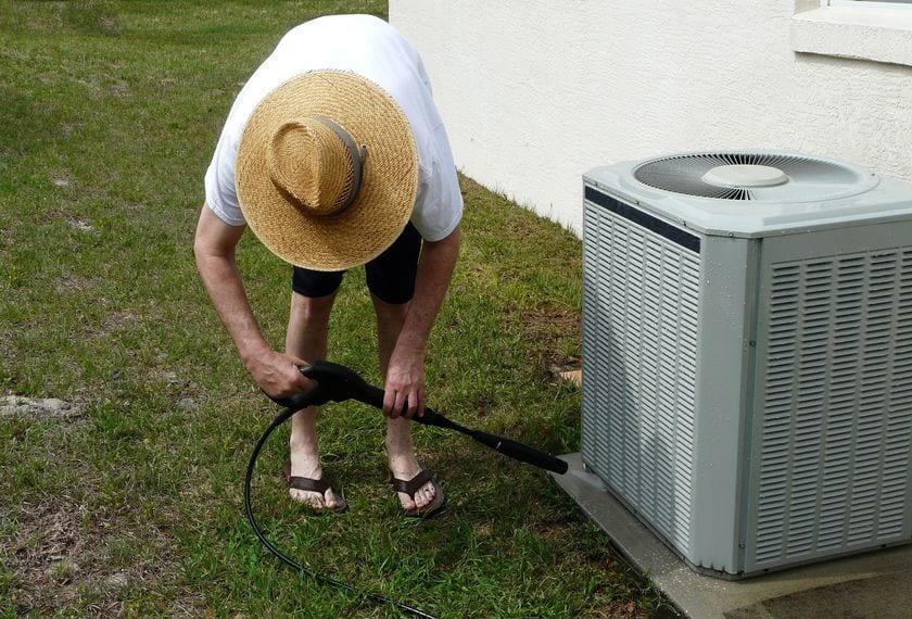 man power washing outdoor ac unit in evanston wy